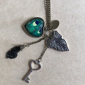 NEW long necklace with green heart and charms